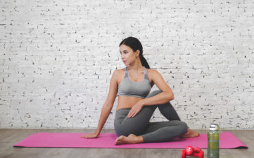 Sport Woman Sitting Relax On Pink Mat And Do Fitness Exercise Wi