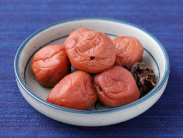 Japanese Food, Pickled Umeboshi In A Dish On Table